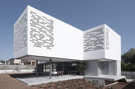 House with Perforated Facade
